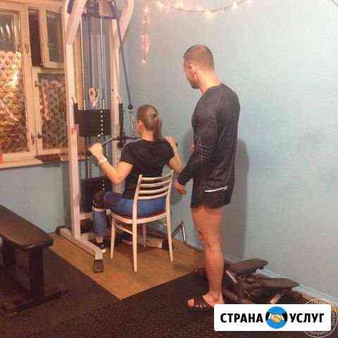 Персональный тренер в тренажёрном зале Мурманск