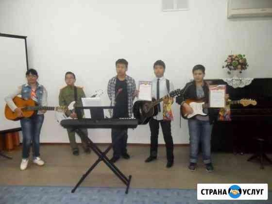 Обучение игре на гитаре и укулеле на дому или дист Элиста