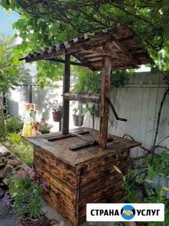 Декоротианые колодцы для дома и дачи Хлевное